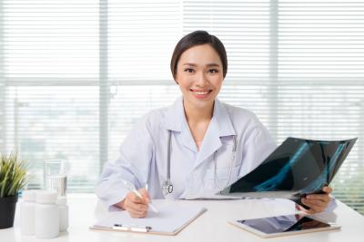 female doctor examining Xray